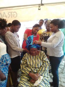 Empowerment Pictures - tying of gele at Christ Orphange Home